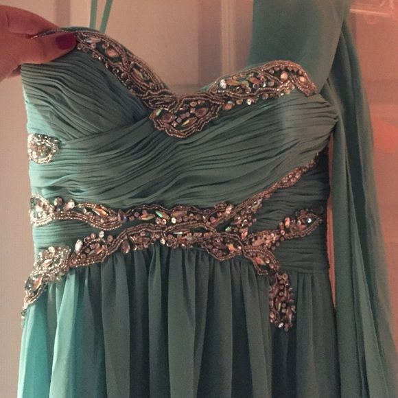brand new Negotiable! Long gown. Perfect for prom. Aqua colored dress. Very classy. Never worn. Will take offers. Dresses Strapless