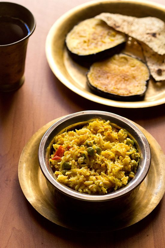 bhaja muger dal khichuri or moong dal khichdi – one pot meal of rice, moong dal, vegetables that is made during durga puja celebrations.