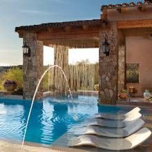 This negative-edge pool has it all—deck jets, fog system, gas lanterns and a rain curtain that projects a spectrum of colors, thanks to fiber-optic lighting.: Lounges Chairs, Dreams Houses, Mediterranean Pools, Design Ideas, Water Features, Gas Lanterns, Bere Fine, Pools Design, Rain Curtains