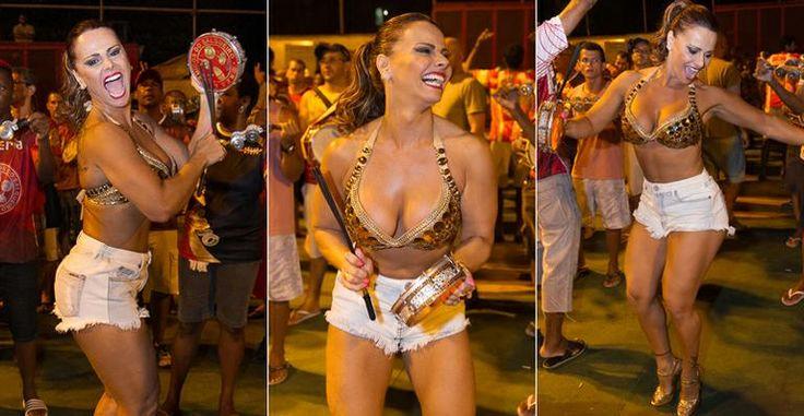 Com o noivo, Viviane Araújo dança em ensaio de rua do Salgueiro