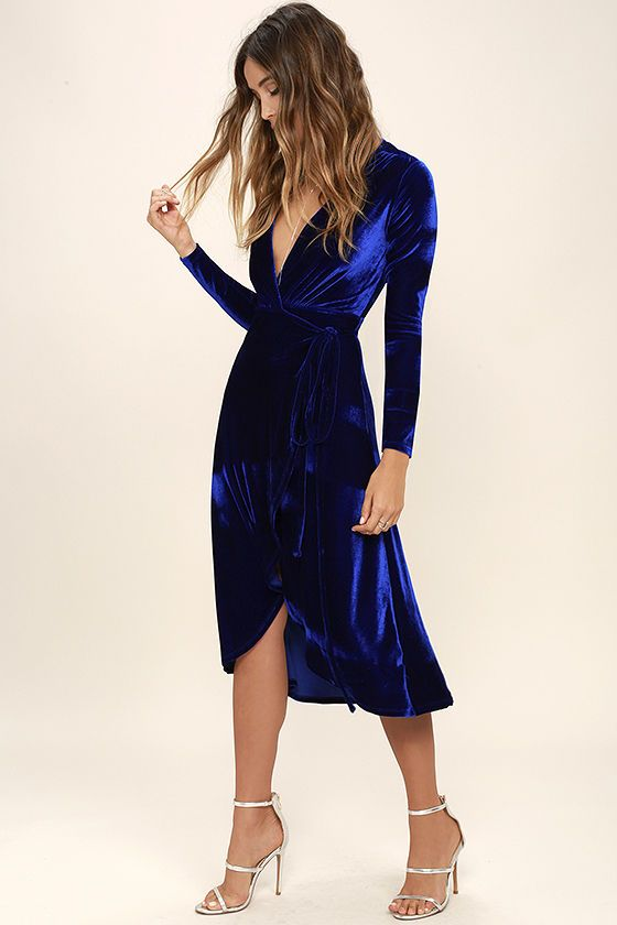 The Enchant Me Cobalt Blue Velvet Midi Wrap Dress is bewitchingly beautiful! Velvet is soft and stretchy across long sleeves and a wrapping surplice bodice, with a tying waist. Wrapped detail carries into a front slit midi skirt.