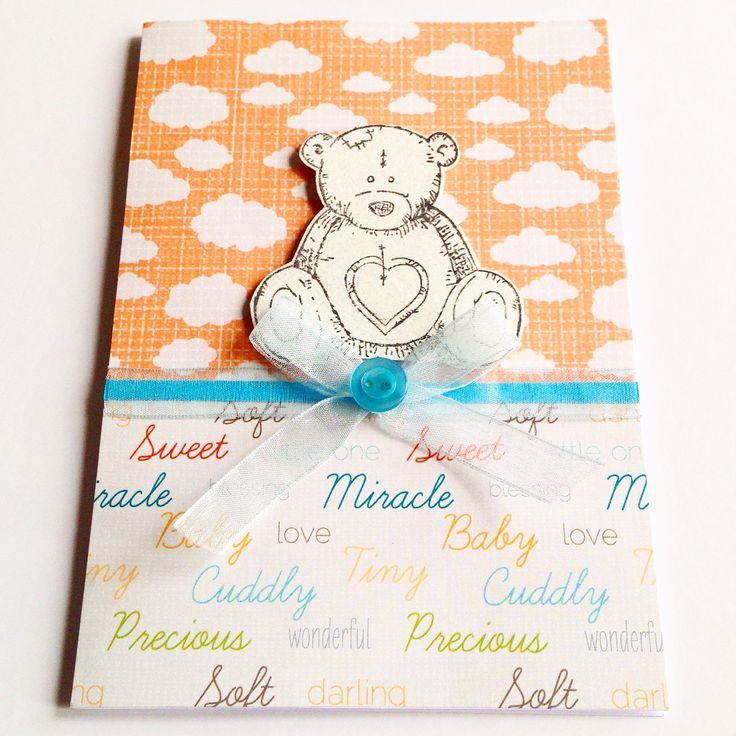 Baby boy's card - with cute teddy bear stamp and finished off with blue ribbon and button.