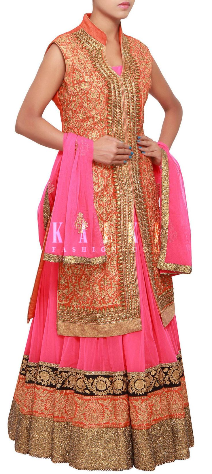 Buy Online from the link below. We ship worldwide (Free Shipping over US$100) http://www.kalkifashion.com/pink-anarkali-suit-matched-with-orange-jacket-embroidered-in-zari-and-sequence-embroidery-only-on-kalki.html