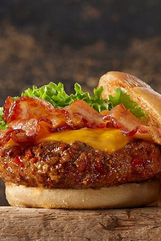 Bacon cheeseburger anyone? Add major flavor to this grilled burger recipe by seasoning with a blend of sweet brown sugar, bourbon, red bell pepper and spices.