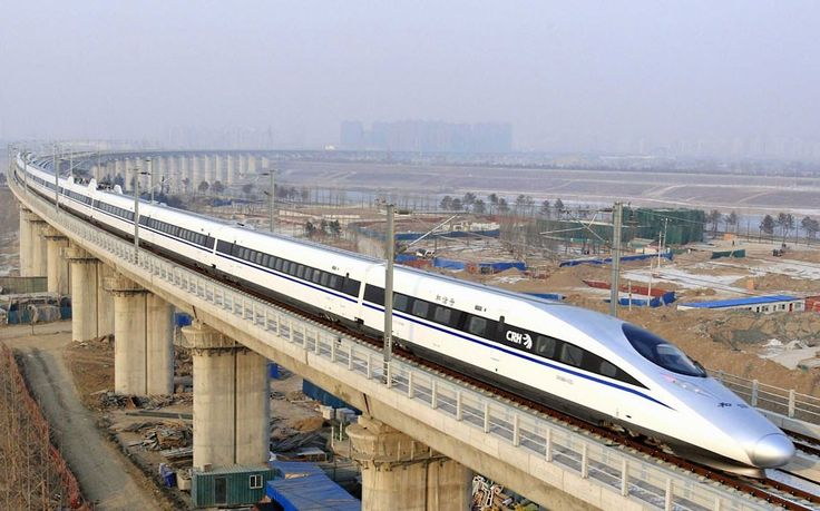 Bullet train G801 leaves Beijing West Railway Station. The world's longest high-speed rail route, linking Beijing and Guangzhou, started operation on Wednesday. Running at an average speed of 300 kilometres per hour, the 2,298-kilometre route will cut the travel time between Beijing and Guangzhou from more than 20 hours to around eight.  Picture: CHINE NOUVELLE/SIPA / Rex Features