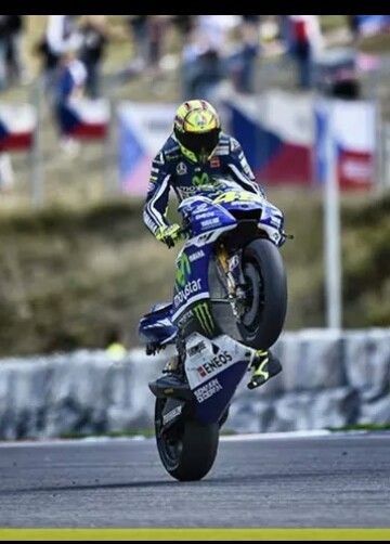 Awesome one legged wheelie by Valentino Rossi at Brno 2014