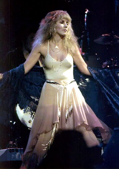 Stevie onstage in a lovely pale outfit, during her 'Bella Donna' tour in 1981  ☆♥❤♥☆     'Bella Donna' is Stevie's debut studio album which was released on July 27th, 1981  ~  https://en.wikipedia.org/wiki/Bella_Donna_(album)