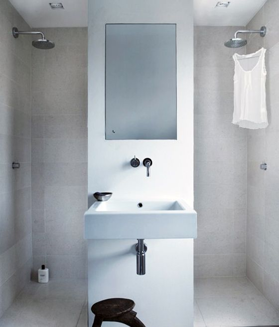 A very clever way to divide a room for more practical usage, suddenly two showers are at the top of my wishlist