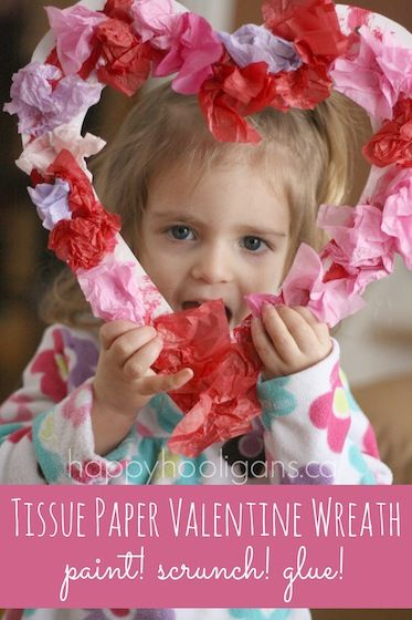 TISSUE PAPER VALENTINES WREATH - Kids LOVE this art process!  They love the sound and feel of crumpling up the tissue paper.  Great for developing fine-motor skills and hand and finger muscles. - Happy Hooligans