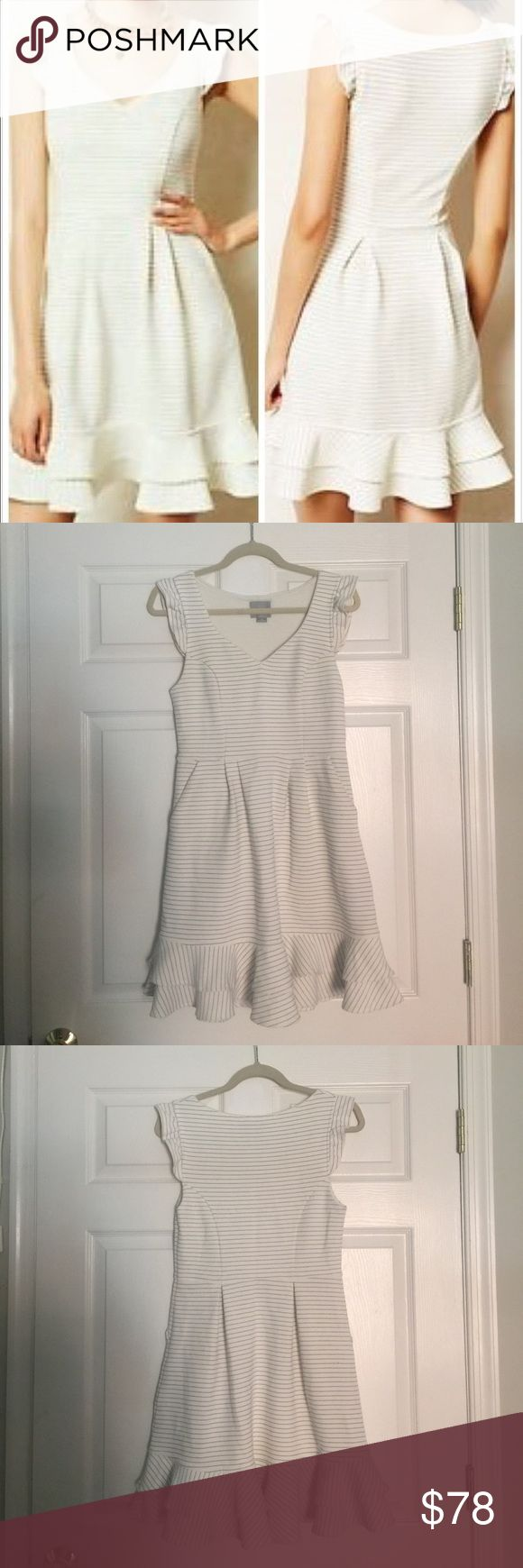 White Maeve dress White with gray pin stripes. Sweet ruffle details at the hem and shoulders. Structured fabric is very breathable but easy to wear. Slightly stretchy. Only worn twice. Great for graduations, summer night outs, and throwing in your bag for spontaneous travel Anthropologie Dresses