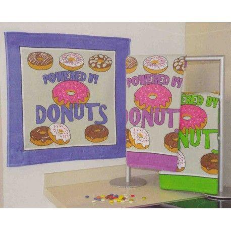 Paño de cocina Donuts. Colorea tu cocina con el diseño más gracioso de los paños de cocina Donuts de Trovador. Estampado colorido de donuts al puro estilo americano, confeccionados 100% algodón para que disfrutes de la máxima suavidad y capacidad absorbente, algo muy útil y práctico en nuestra vida cotidiana.