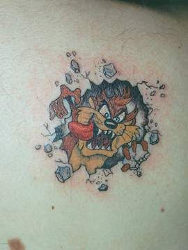 3d busting out taz tattoo