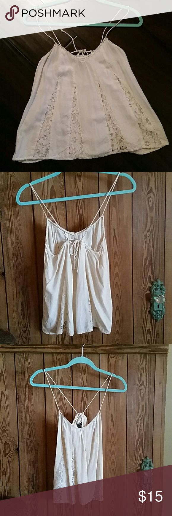 AEO cream strappy top Cream with lace insets. Straps tie in back and allow for adjusting how high or low the neckline is. Worn twice. Perfect condition! American Eagle Outfitters Tops