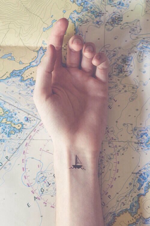 Small sail boat tattoo