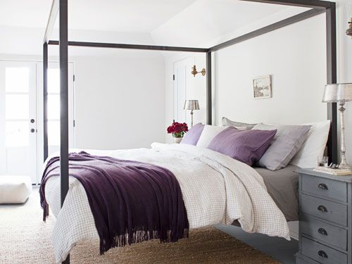 A duvet by Toast and purple throw from West Elm turns this into a soft, cozy bedroom. #decorating