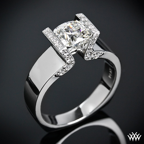 Romance me: Brilliant from all sides, this Custom Half Bezel Solitaire Engagement Ring is set in Platinum and features a 1.15ct Square Hearts and Arrows Diamond. The squared off head is adorned with 0.40ctw A CUT ABOVE® Hearts and Arrows Diamond Melee and two surprise blue sapphires are set inside the shank.
