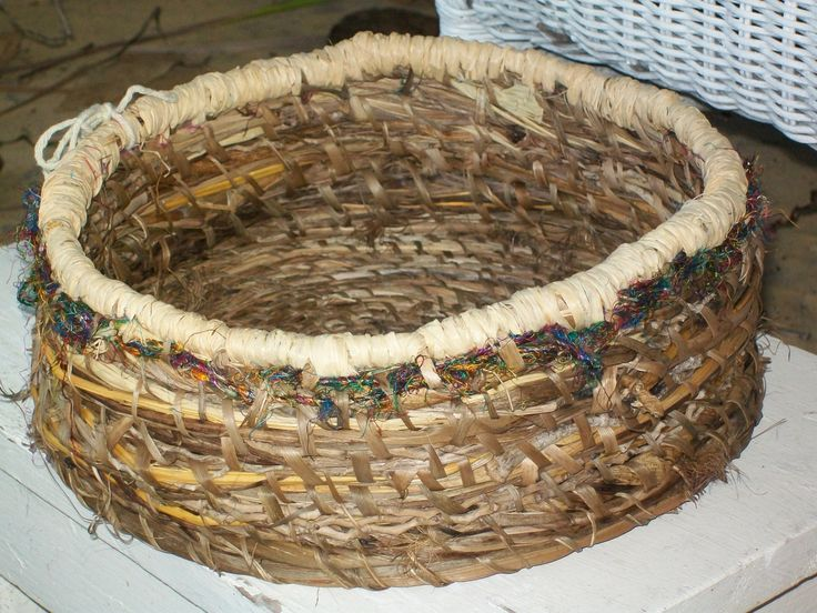 Stitched by me, trimmed with raffia, stitched with cordyline,
