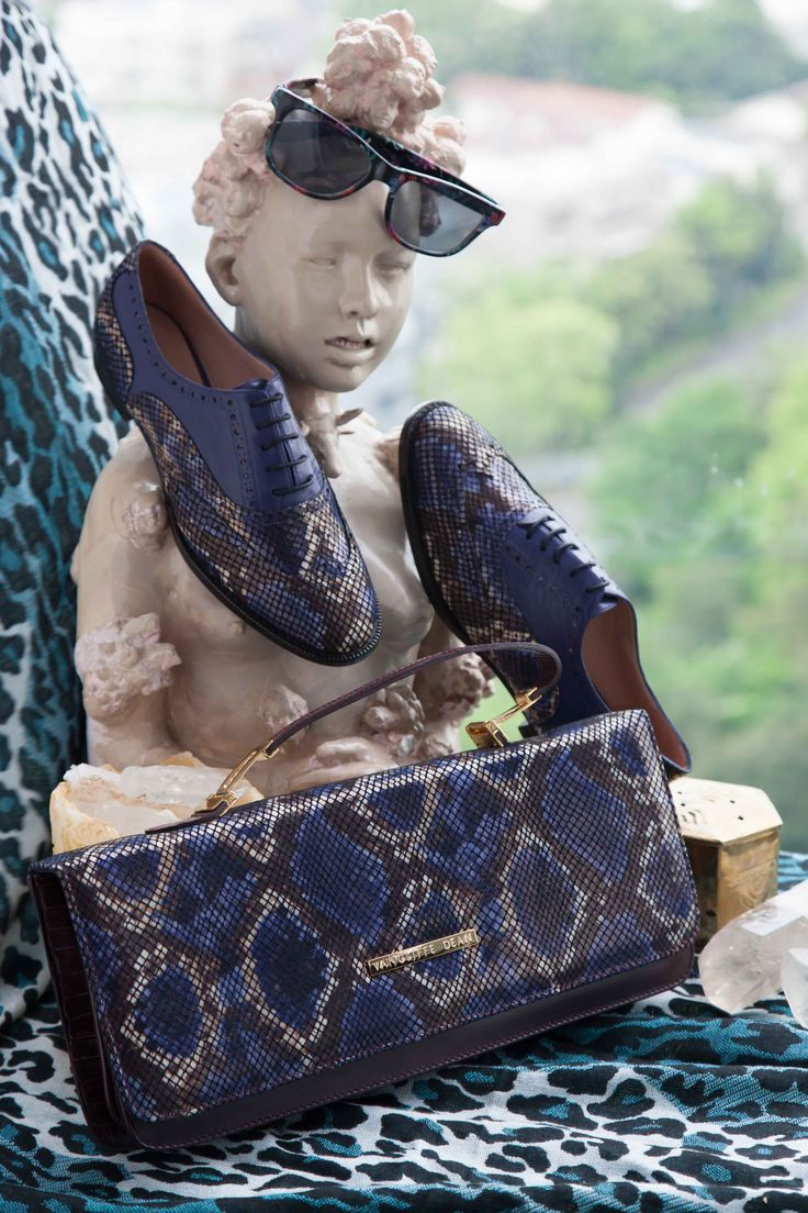 Check out this guy! Matching is in this season so how about this pair of mock snake print brogues and East West clutch! #fashion #snakeprint #purple #shoes #handbags