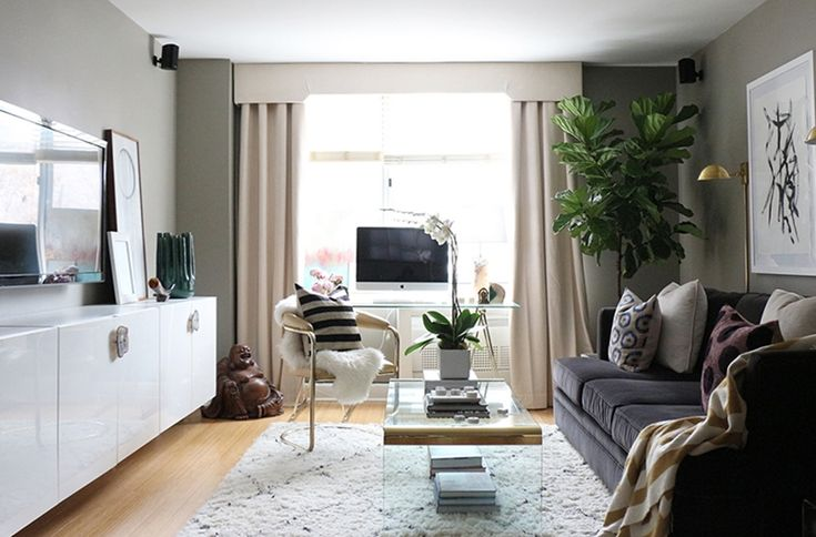 Victoria Solomon's New York City Apartment Tour #theeverygirl. Like the console, sconces, overall warmth and windows