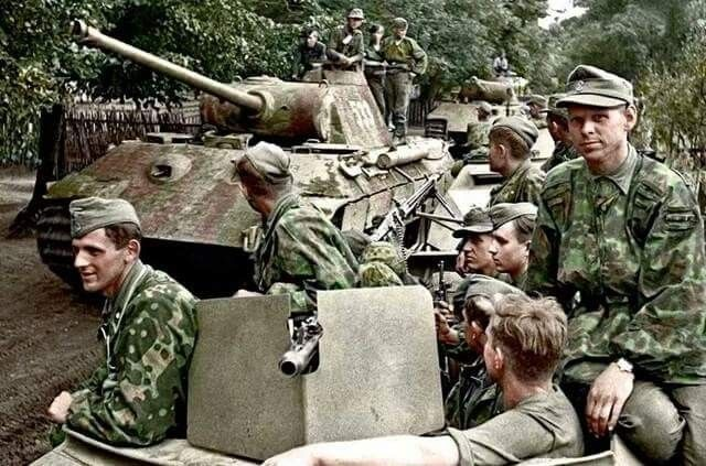 """Sd.kfz 251/3 and Panzer V """"Panther"""" of Kampfgruppe Muhlenkamp from 5 SS-Pz-Div. """"Wiking"""" (consisting of SS-Pz-Regt.5 and III Btl.SS-Pz Grenadier Regt. """"Germania"""") in eastern Poland during Operation Bagration July 1944. Colourised by Doug"""