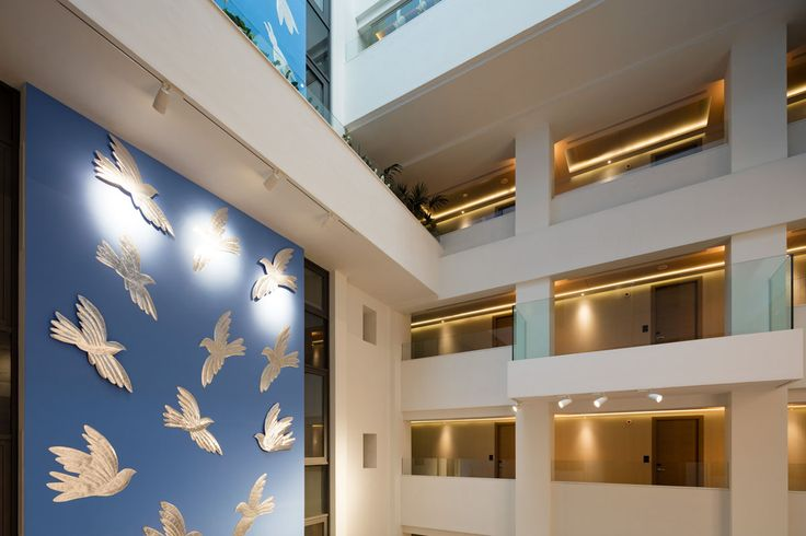 We are proud to display this towering work of art created by Alekos Fassianos, one of Greece's greatest living artists, in our Atrium. The natural light that shines in from the ceiling reflects on the silver-plated birds, giving the illusion of movement and flight.