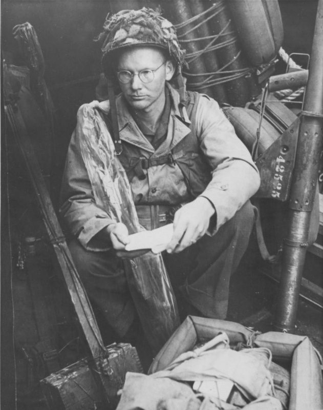 A US soldier along with his bible while heading towards Normandy, June 1944. WWII