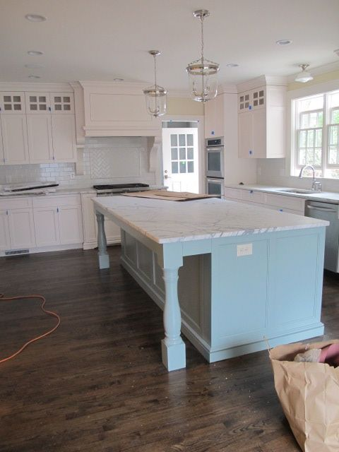Is anything more beautiful than these white cabinets...cream walls and blue island...love the lighting!!!! Originally posted on