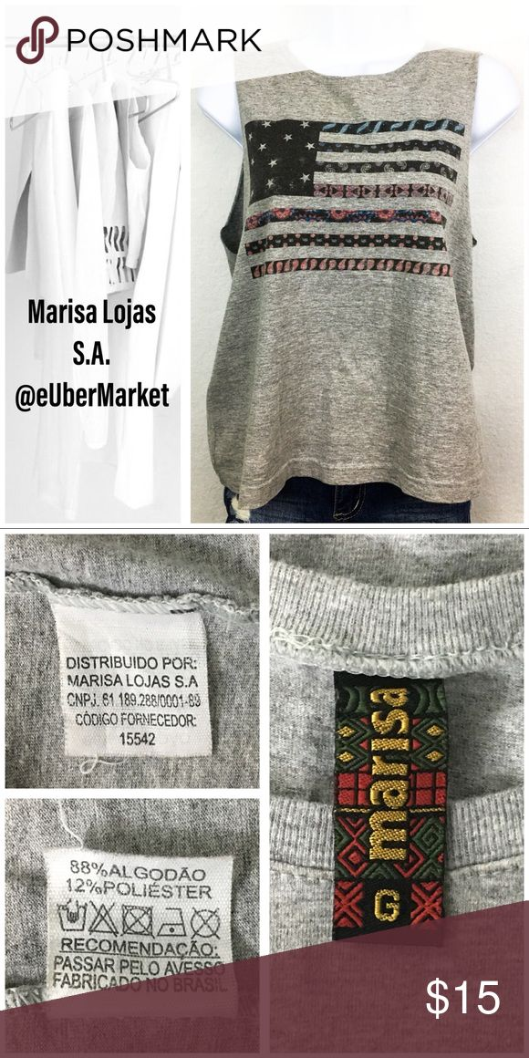 Marisa Lojas S.A. Grey Sleeveless T-shirt Size L EUC Marisa Lojas S.A. sleeveless grey t-shirt top with a multi-color American Flag print on the front, perfect for warm weather and outdoor parties. Light weight and soft. Great with jeans, shorts, or sweat pants.   Material & laundry info - read photo.  Check my listings for matching bottoms & accessories Marisa Lojas S.A. Tops