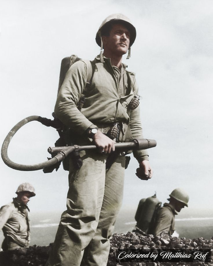 Corporal Charles W. Lindberg, a US Marine, with a flame thrower on Iwo Jima - 1945 Lindberg helped raise the first American flag above Mount Suribachi on 23 February 1945 and was awarded the Silver Star Medal for his actions as a flame thrower operator on Iwo.