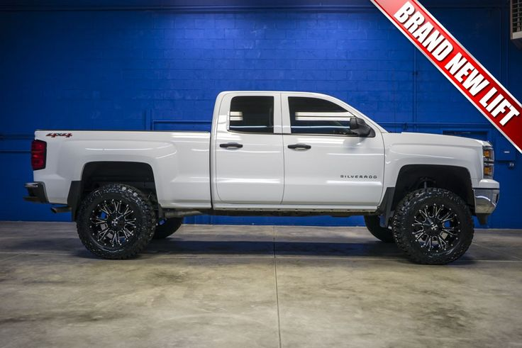 Newly Lifted 2014 Chevrolet Silverado 1500 LT 4x4 truck with custom wheels and tires For Sale At Northwest Motorsport