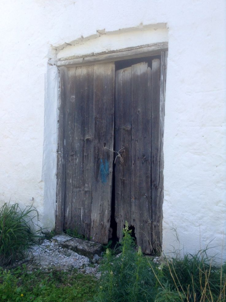 Old door in Metochi, Agistri Island, Greece