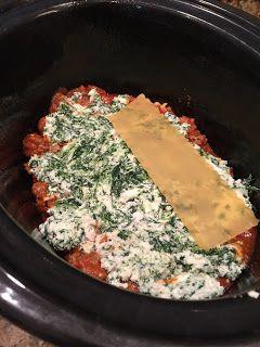 Crockpot Lasagna - 1 jar pasta sauce - 1lb Italian Sausage  - 1 cont (15 oz) Ricotta Cheese - 2 cups shredded mozzarella - 9 oven ready lasagna noodles  - Italian seasoning - Salt - 1/2 cup water - 10oz frozen spinach
