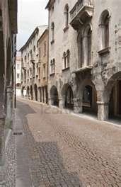 ... cobblestone street and old houses in italian town of Vittorio Veneto