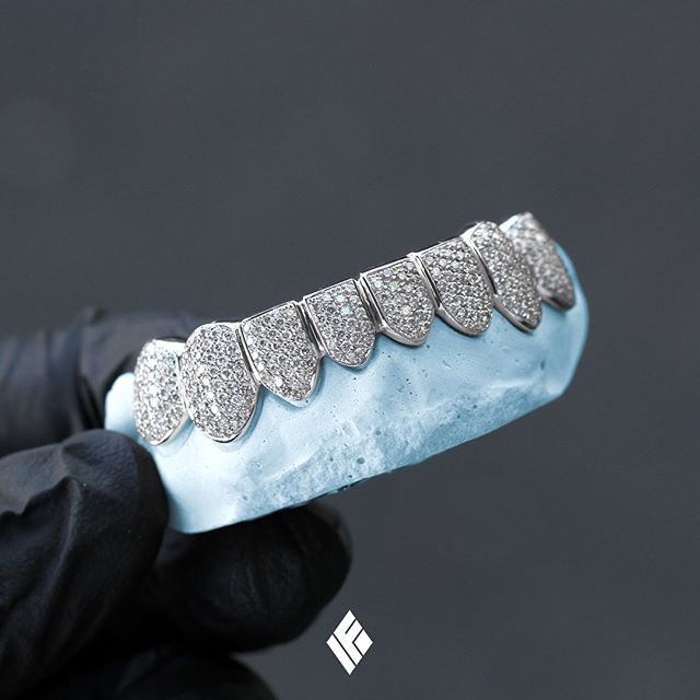 Solid 14K White Gold Bottom 8 Grills Fully Iced Out With White Diamonds. Custom made for @thesupremetaco  #Grillz #DiamondTeeth #CustomJewelry #IFANDCO
