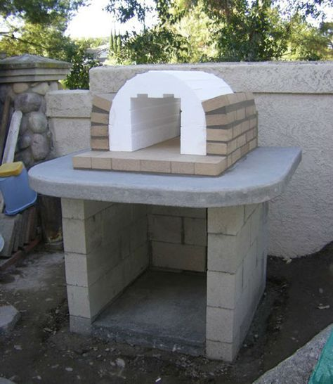 Applying the first layer of firebrick to the Mattone Barile Wood-Fired Brick Pizza Oven foam form | Pizza ovens in 2018 | Pinterest | Oven, Pizza oven outdoor …