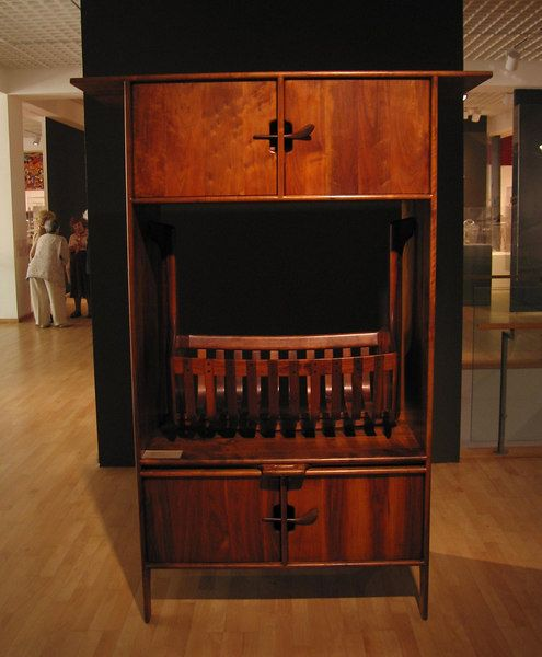 I've never seen this before.it's a cabinet built by Sam Maloof to hold a cradle he also built. It's at the Mingei Museum in La Jolla, CA.
