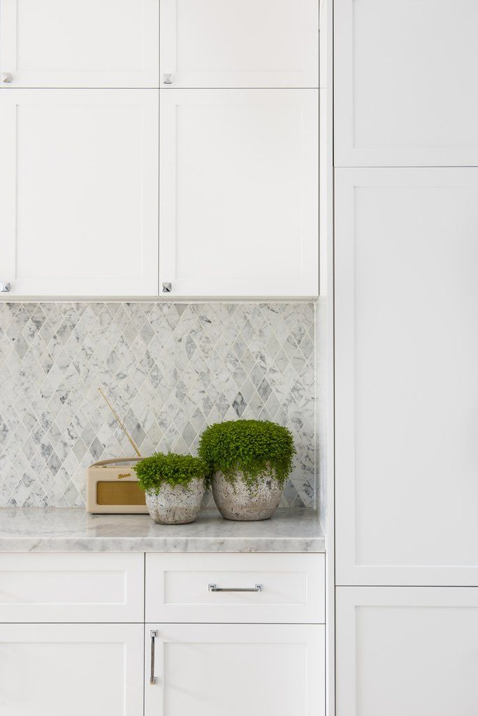 Carrara diamond mosaic is a glamorous addition to the minimal, monochrome interior scheme of picturesque kitchen created by Aaron Wong. Featured Products — Carr