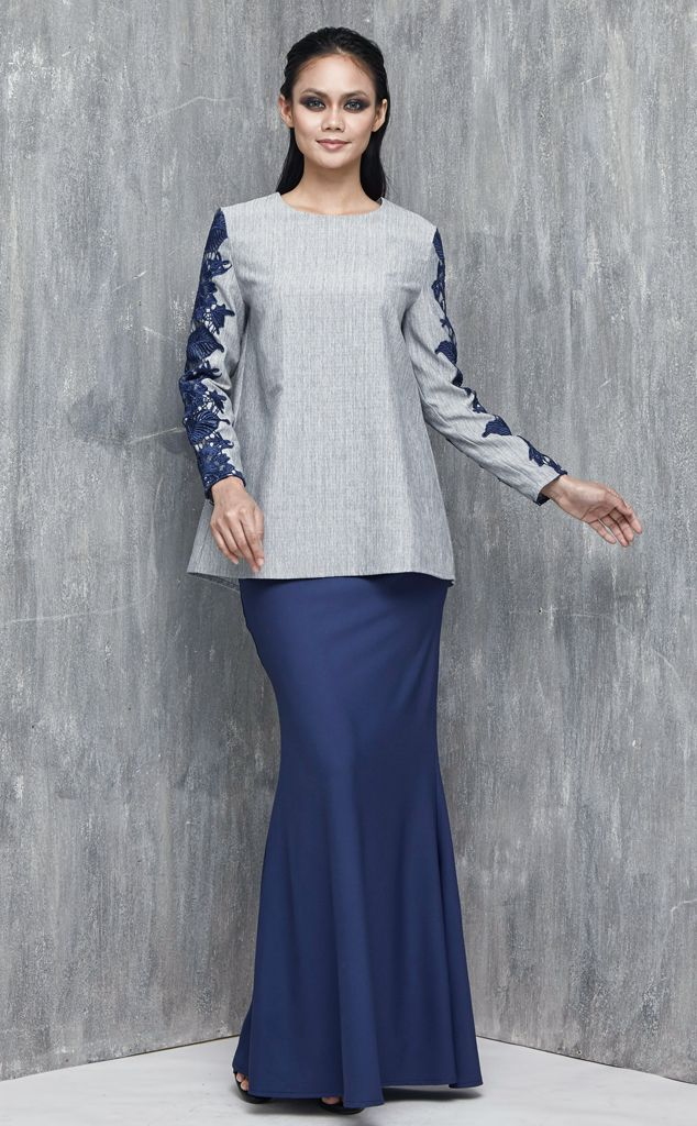 EMEL X DAPHNE IKING - LONGHORN - Modern A-line Baju Kurung with Lace (Blue) This A-line modern baju kurung is all about the class and simplicity with border lace on the sleeves. Also, the top is a tweed inspired fabric that's makes a lovely ensemble with the border lace. #emelxCLPTS #emelxDaphneIking #emelbymelindalooi #bajuraya #bajukurung #emel2016 #raya2016 #DaphneIking #lookbook #aline #lace #blue
