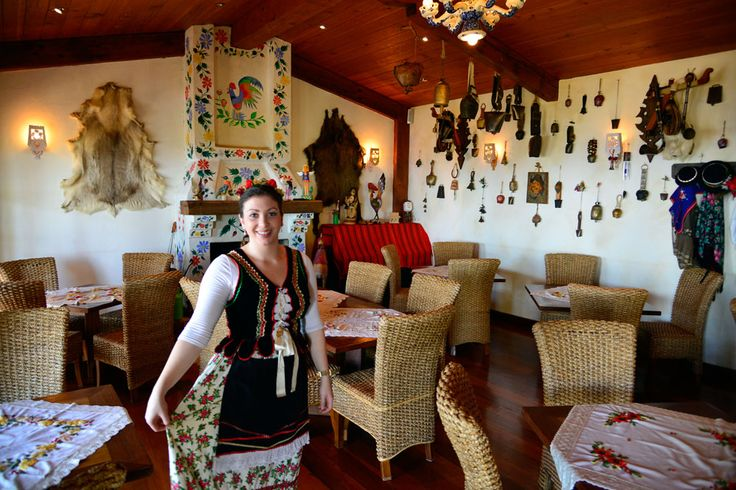 Waitress in traditional Polish dress inside The Polish Place dining room in Mt Tamborine