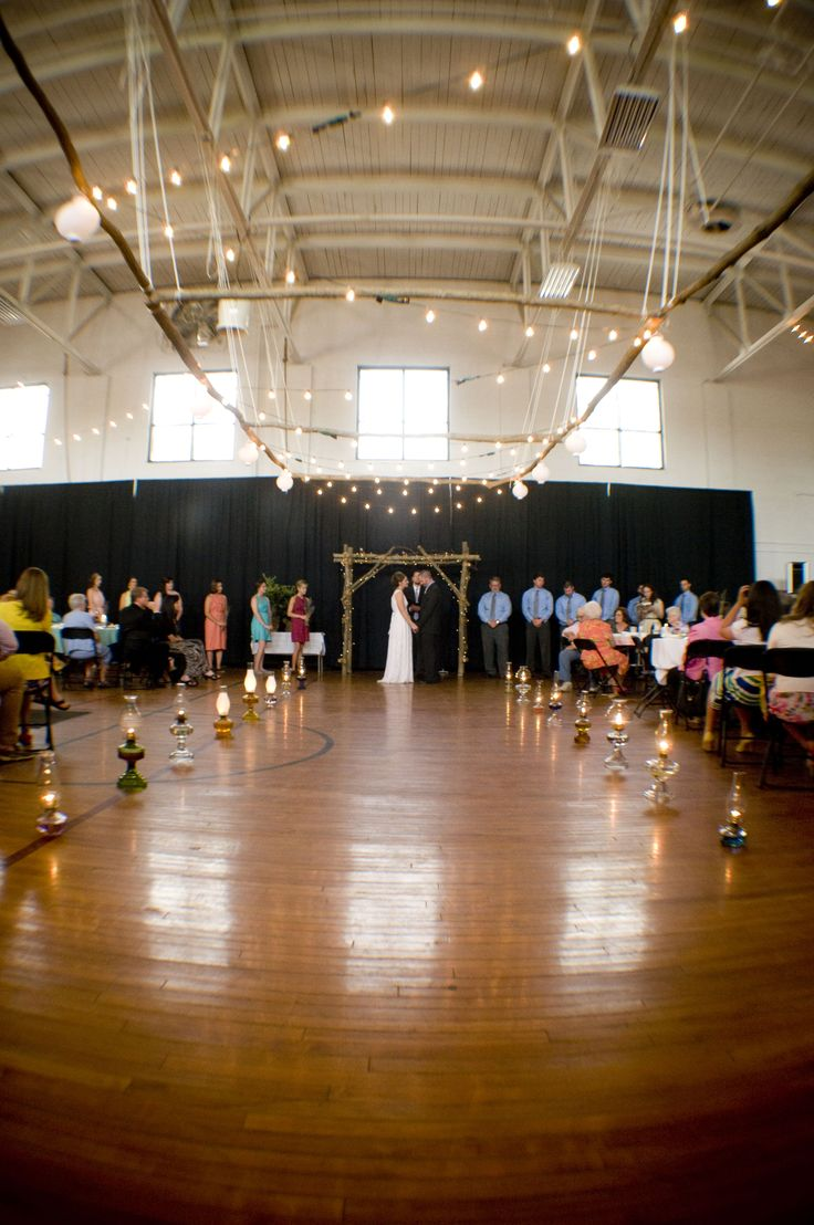 We got married in a gym!  Wedding & Reception in the same location.  Works great!