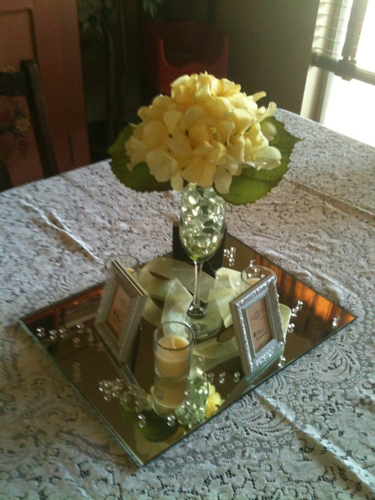 Perfect simple centerpiece,  most of the items, with the exception of the mirror and the silk flower comes from the dollar stores!