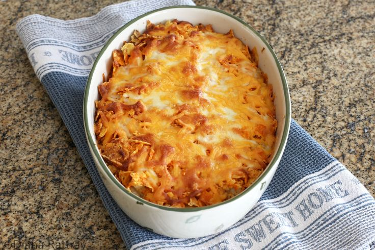 This family-pleasing Doritos chicken casserole is made with a delicious chicken filling, cheese, and a crushed Doritos crust and topping.