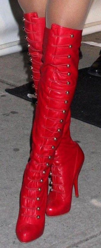 """Ronfifi"" Over-the-Knee Boots in red by Christian Louboutin (© 2009) (Worn by Ciara, photo by FlynetPictures.com.)"