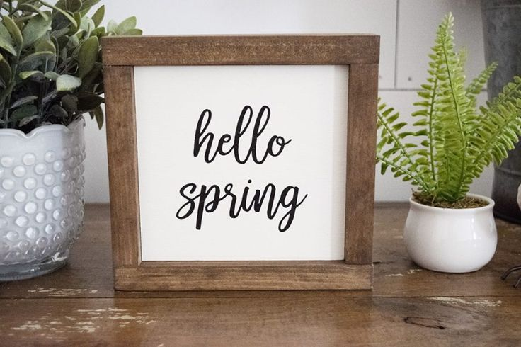 """Hello Spring Farmhouse Style Sign - Welcome spring it your home with our adorable """"hello spring"""" framed sign. #farmhousestyle #farmhousedecor #fixerupperstyle #spring - Spring decor - Spring decorating - white farmhouse"""