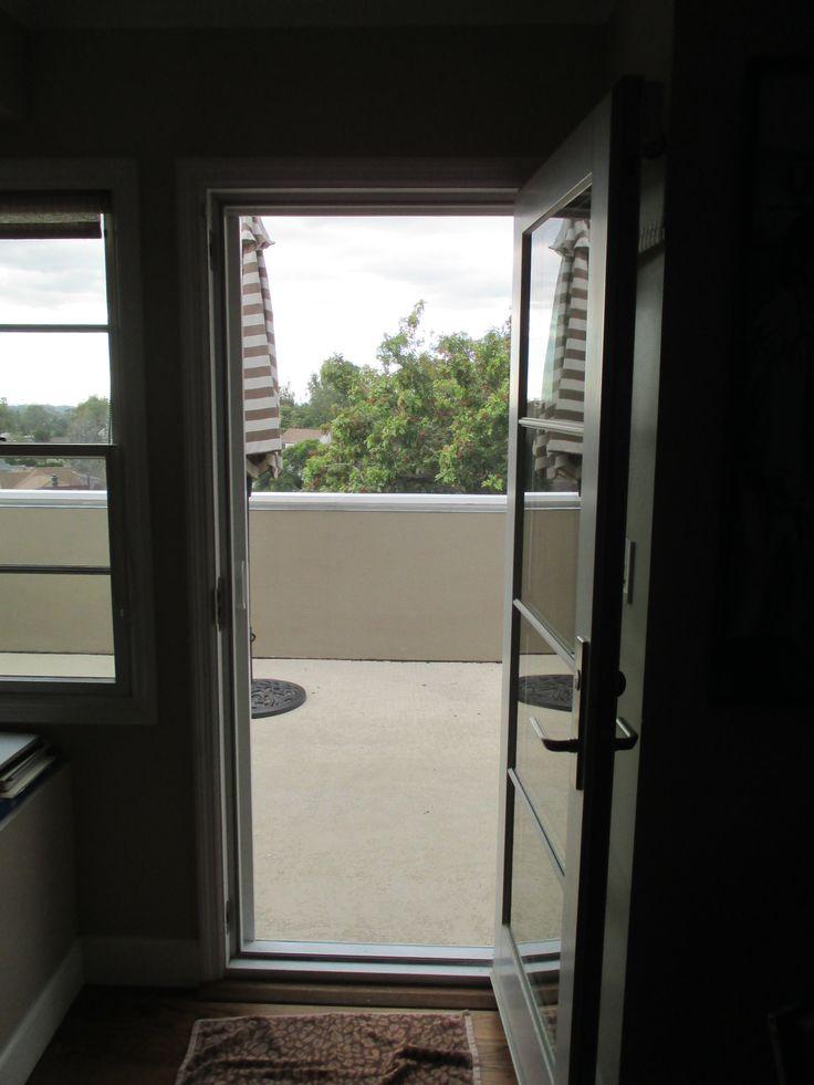 Single white stowaway retractable screen door with black for Single sliding screen door