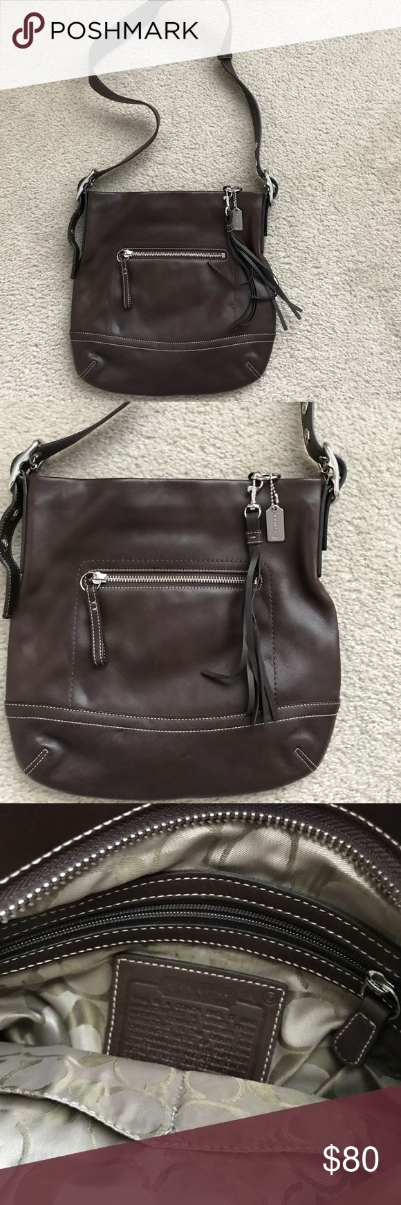 Coach leather bag This bag is in very good condition.  Inside has no stains or flaws.  Straps are in perfect condition as noted in pictures. The tassel is detachable if you prefer the bag without it. Great bag for the fall. COACH Bags