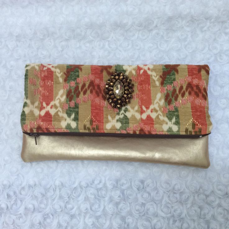 Foldover clutch with applique in gold vinyl