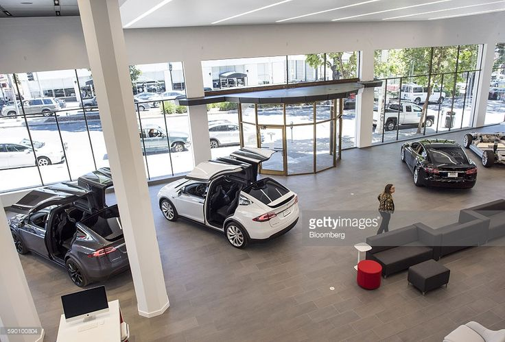 Tesla Motors Inc. vehicles are displayed at the company's new showroom in San Francisco, California, U.S., on Wednesday, Aug. 10, 2016. Tesla Motors Inc. marked the opening of its largest North American sales, service and delivery center in San Francisco, a key market from which Elon Musk's electric-car maker will introduce its all-important Model 3 sedan late next year. Photographer: David Paul Morris/Bloomberg via Getty Images