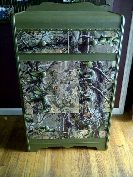 This is a chest that I re-did for my sons bedroom. This is the After Picture. I used realtree camo wrapping paper and modpodge. Painted the whole chest with moss green paint, when everything was done I went over the wrapping paper and mod podge with a clear coat varnish. It looks great!