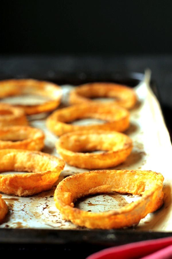 Crispy Baked Onion Rings... These are actually good for you! They are baked, gluten free, dairy free, and taste amazing! They have all the crunch of fried rings, with a quarter of the calories and fat.
